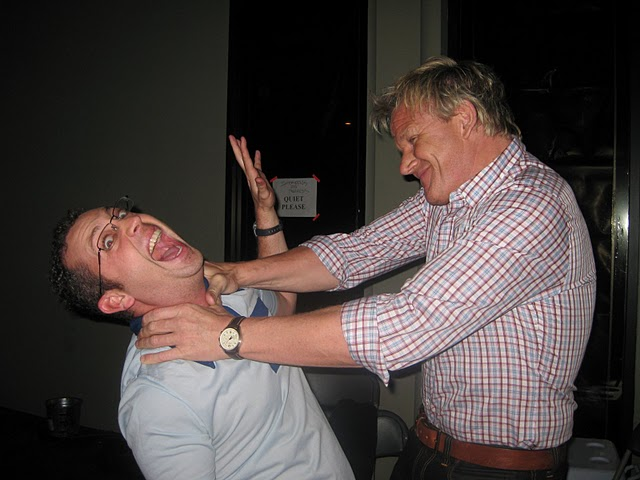 Gordon Ramsay playfully strangles Ben Starr behind the scenes on MasterChef
